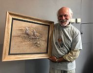 Alan Hunt with his donated Turtle Dove original art work