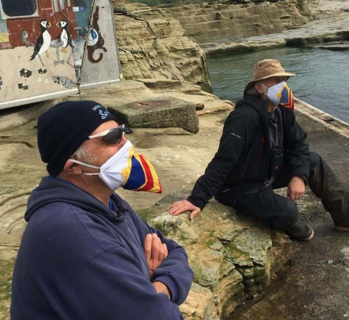 The wardens on Coquet sporting their very smart Covid Puffin masks