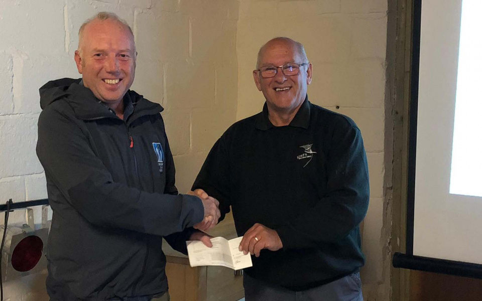 YCN Director Richard Baines making the donation of £500 in 2019 to Spurn Chair Rob Adams